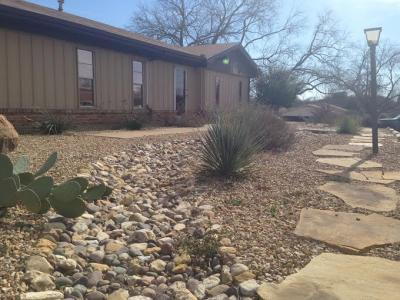 Landscape rock fort worth quick mini garden makeover for Landscaping rocks adelaide